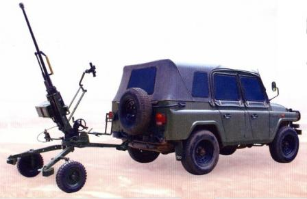 14.5 mm QJG 02G heavy machinegun (export modification) towed by jeep-type vehicle.