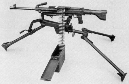 SIG MG 710-2 (MG 57-2) machine gun in medium role, on tripod and with 200-round belt in separate box.