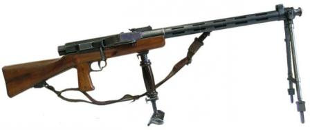 Furrer Lmg-25 light machine gun with additional monopod support.