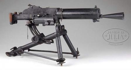 Schwarzlose M1907/12 machine gun on standard Austrian tripod; spade grips are folded up.