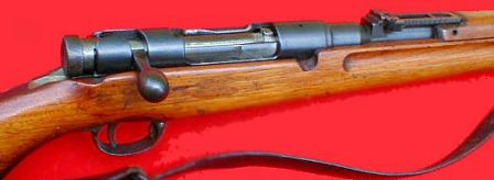 6.5mm Arisaka Type 38 rifle, close-up view on the receiver; bolt cover is removed.
