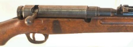 6.5mm Arisaka Type 38 rifle, close-up view on the receiver; bolt cover is installed.