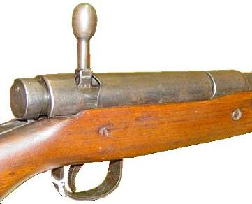 7.7mm Arisaka Type 99 rifle, close-up view on the receiver, bolt cover installed, bolt handle is turned up and ready to be pulled back.