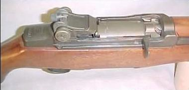 Close-up view on the receiver, bolt in closed position, charging handle and rear sight of the M1 Garand.