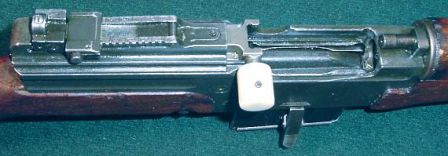 MAS-49/56 rifle - view on the receiver. Bolt is retracted to the rear and is locked by the bolt stop; clearly seen are the diopter rear sight, the stripper clip guides machined in to the bolt carrier and the gas tube end (at the right, above the barrel breech opening).