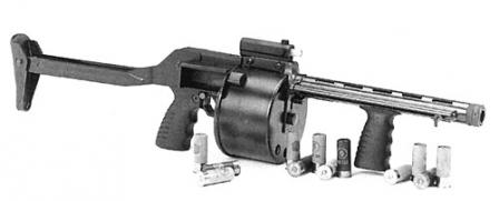 The Protecta shotgun, with the butt unfolded. Note the ejector rod located along the barrel, and the lack of the cylinder winding key, which is not required in this design.