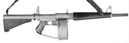 Atchisson assault shotgun (ca. 1972), blowback operated, with 20-round drummagazine.