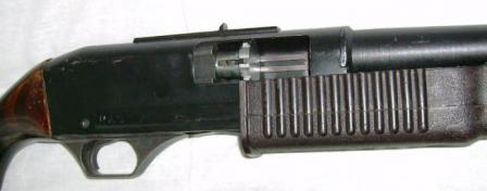 KS-23 weapon, right side close up with bolt partially retracted to showits rotary locking head.