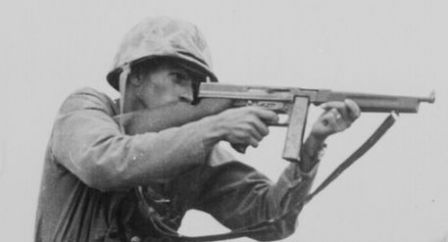 An American Soldier fires his Thompson submachine gun (WW2).
