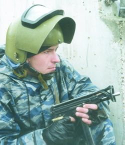 A Russian law enforcement officer holds a compact submachine gun during a counter-terrorism operation (2005).