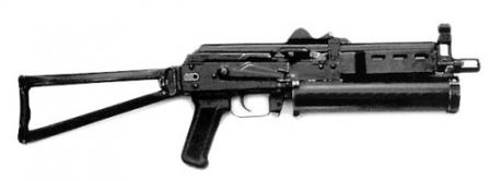 Early model of Bizon submachine gun, with AKS-74 type butt and pistol grip, andwith 64 rounds cylindrical magazine.