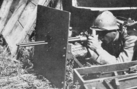 Villar-Perosa M1915 twin-barrel submachine gun in action, on light tripod and with armored shield (in light machine gun role). WW1 era photo.