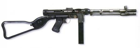 Rexim Favor submachine gun in one of the original configurations, with skeletonized butt and spike-type bayonet (in stored position).