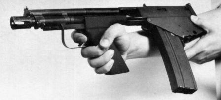 The IMP-221 / GUU-4/P individual multi-purpose weapon. Note that the pistol grip is canted to the side to provide comfortable hold.