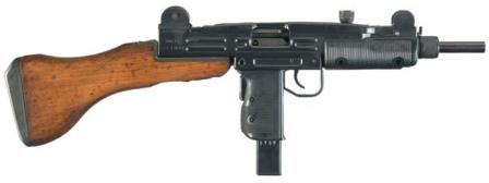 Uzi submachine gun with fixed (detachable) wooden buttstock.
