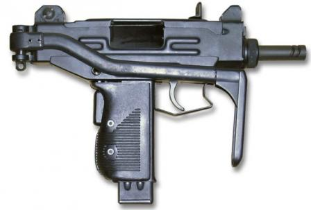 Micro-Uzi submachine gun with shoulder stock folded.
