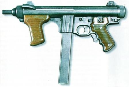 Beretta PM 12 (early version, with pushbutton safety); buttsock is folded.