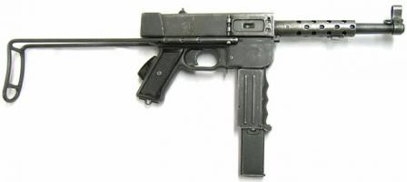 MAT-49 submachine gun, right side. Shoulder stock is retracted, ejection window dustcover is closed.