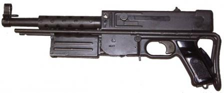 MAT-49 submachine gun, with shoulder stock retracted, magazine removed and magazine housing folded forward for compact storage or transportation.