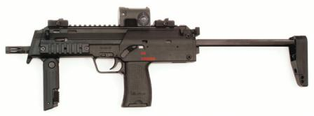 HK MP7A1 submachine gun / personal defense weapon in standard configuration,with shoulder stock and foregrip in firing position, and with collimating sightinstalled on top rail.