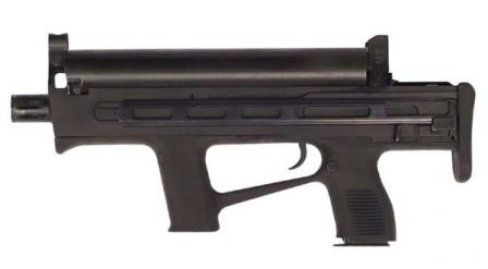 Early version of Chang Feng submachine gun chambered for 5.8x21 DAP58 ammunition; this weapon had dual feed option, with primary helical magazine located at the top of the receiver and secondary pistol-type magazine located in the rear grip.