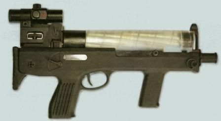 Current version of the Chang Feng submachine gun, chambered for ubiquitous 9x19 cartridge; secondary feed option with pistol magazine is omitted from design.Gun is fitted with red dot (collimating) sight.