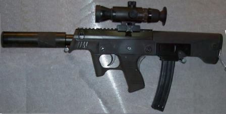 Police-type JS submachine gun, caliber 9x19mm, fitted with telescope sight anddetachable silencer.