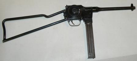 9mm MGD PM-9submachine gun inready position, right side.