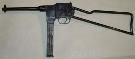 9mm MGD PM-9 submachine gun inready position, left side.