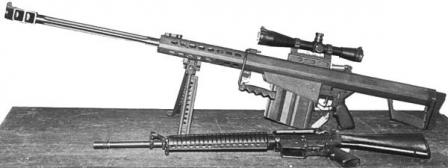 M82A1 rifle displayed next to M16A2 rifle for size comparison.