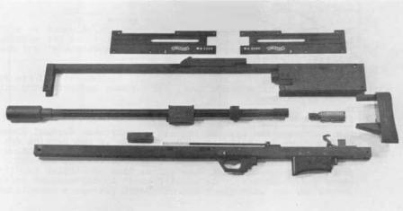 Walther WA 2000sniper rifle body (less wooden furniture and scope) disassembled to main components (from original Walther manual).