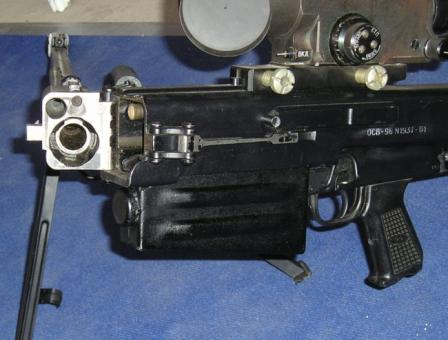 12.7mm OSV-96 rifle with barrel foldedhalf-way to the right, exposing barrel breech area and gas tube exit.Note the barel clamp / lock on the receiver above the magazine.