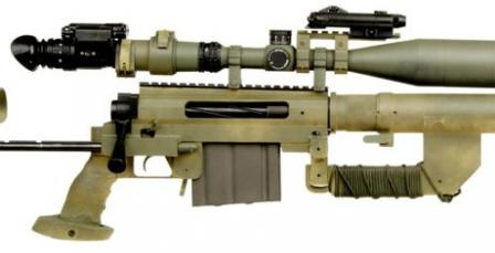 Close-up view on the receiver and controls of the CheyTac Intervention M200rifle. Note large carrying handle under the barrel sleeve, and the scope fittedwith IR night vision module and IR laser.