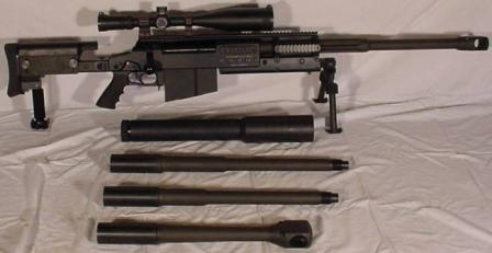 OM 50Nemesis Mk III rifle (production version) with replacement barrels andsilencer (shown nextto the rifle).