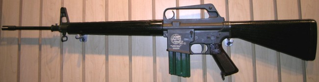 First model ArmaLite Ar-15 rifle, with original 25-round magazine. Note the position of charging handle