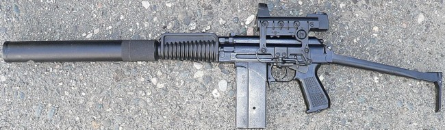 9A-91 compact assault rifle (current production model) with attached  silencer and red