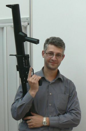 Author posing with RGS-50M grenade launcher; note the size of the weapon.