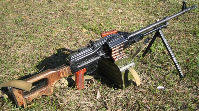Current issue, early production Kalashnikov PKM machine gun, loaded with 100-round belt in box and ready to fire.