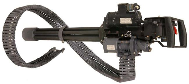 Dillon Aero M134D Minigun of current manufacture, with manual control unit and feed chute.