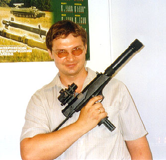 "AEK-919K, latest version, fitted with the ""red dot"" sight and a silencer, held by my friend and correspondent, Gleb Androsov, at the UralExpoArms-2002 exhibition."